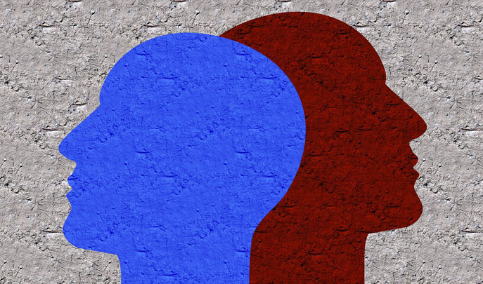 Grafik: graue Wand mit zwei Kopf-Silhouetten